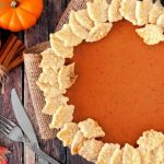 Pumpkin Pie decorated with pastry leaves on a wooden board | Feature | The Best Vegan Pumpkin Pie Recipe