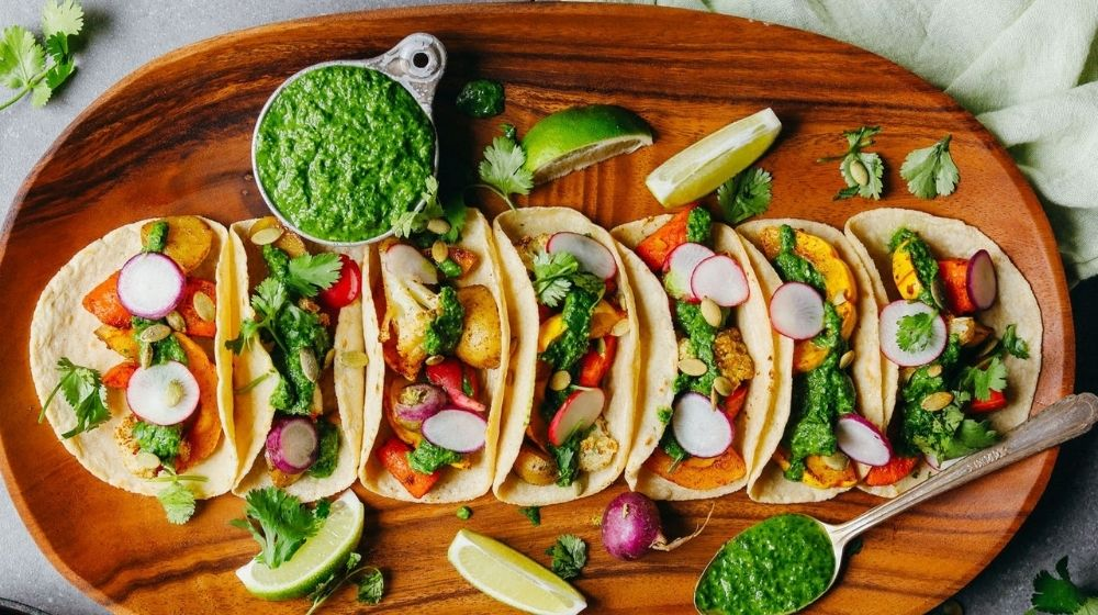 a bunch of tacos are organised vertically | Feature | 10 Mouthwatering Vegan Tacos