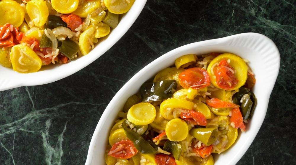 colorful vegan squash casserole on black table   Feature   5 Vegan Casserole Recipes to Bring To A Potluck