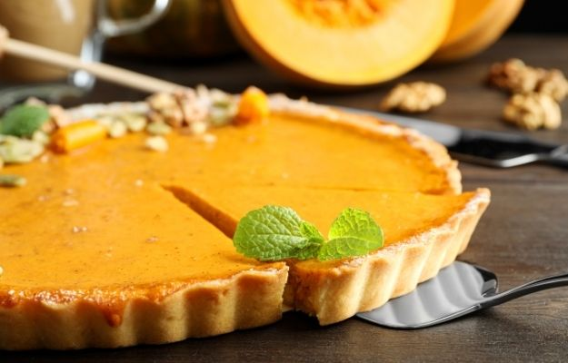 Delicious fresh homemade pumpkin pie on dark wooden table | Vegan Pumpkin Pie | Vegan Thanksgiving Dishes For The Whole Family