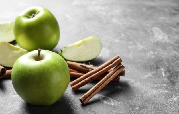 Fresh apples and cinnamon sticks on gray table-ca | Ingredients & Preparation | The Best Ever Vegan Apple Pie Recipe |