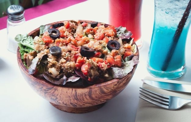 Moroccan salad in a wooden bowl   Moroccan Roasted Vegetable Salad   Vegan Side Dishes For Any Gathering