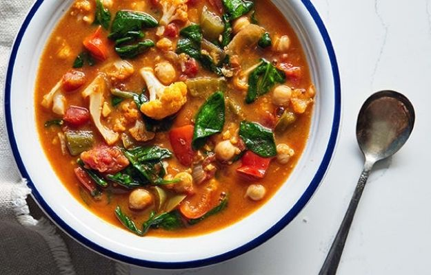 hearty vegetable stew on the white plate | Curried Vegetable and Chickpea Stew | 3 Incredible Vegan Slow Cooker Recipes