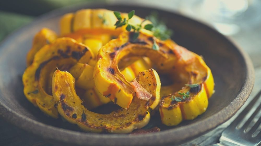 sheet pan with freshly roasted delicate squash with Hazelnuts-feature | Feature | Vegan Side Dishes For Any Gathering