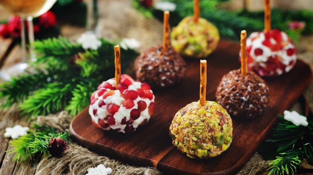 Variation of cheese balls appetizer with pistachio, pomegranate and flax seeds| Feature | 3 Vegan Christmas Appetizers